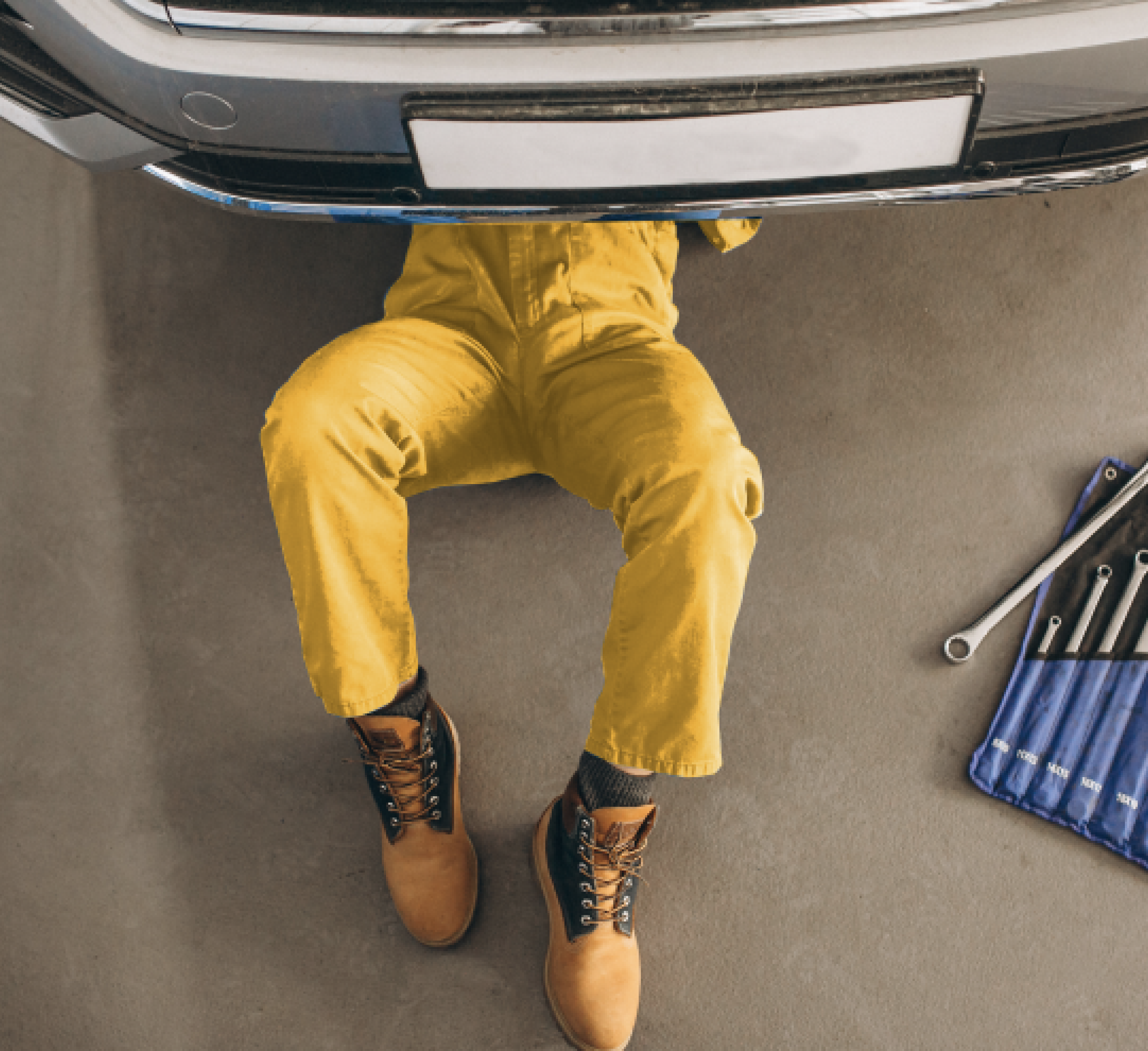 Mechanic inspecting a car for a seller before it is sold on Autochek
